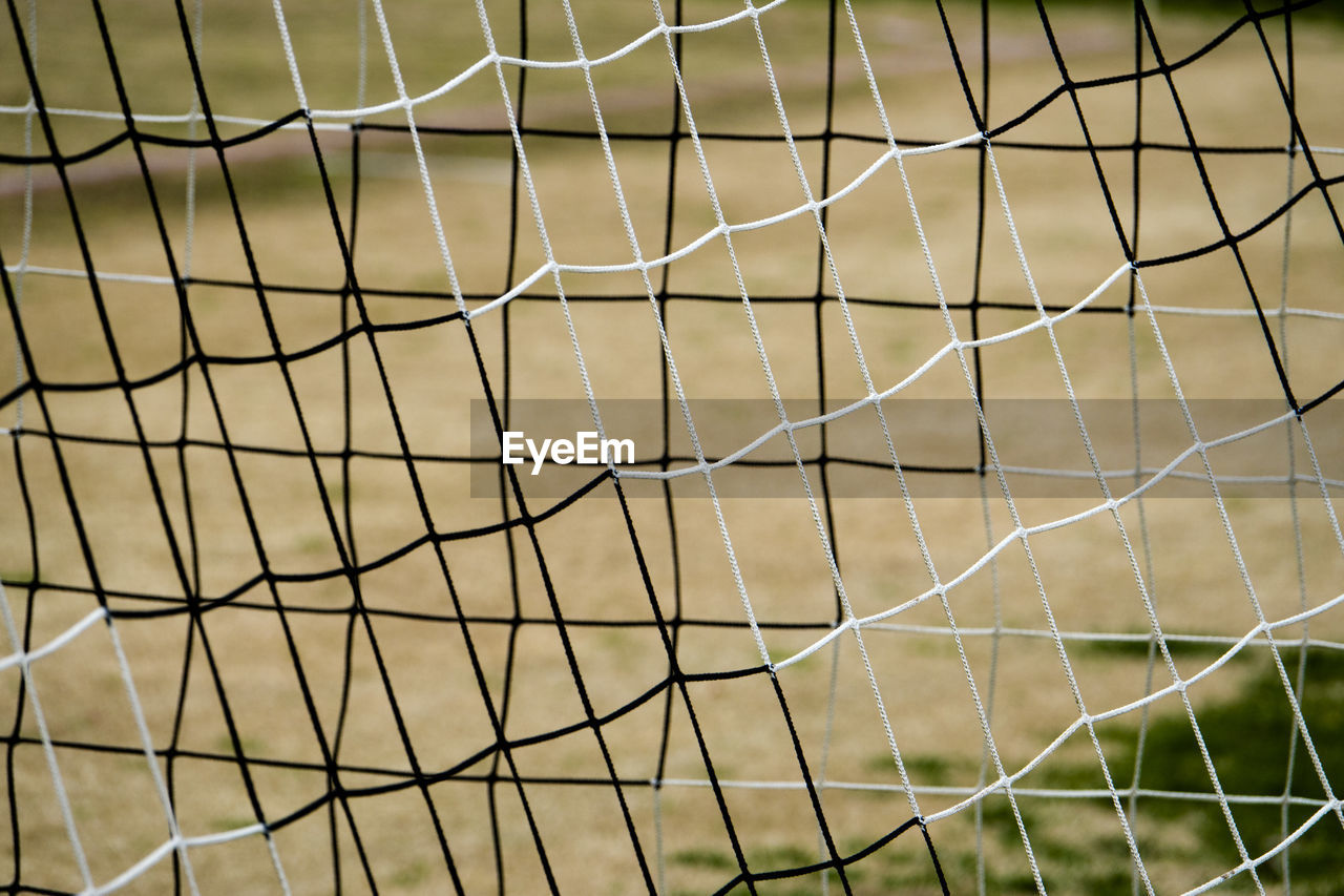 pattern, sport, focus on foreground, backgrounds, no people, full frame, close-up, soccer field, net - sports equipment, soccer, netting, nature, sports equipment, day, grass, selective focus, soccer goal, outdoors, fence, team sport