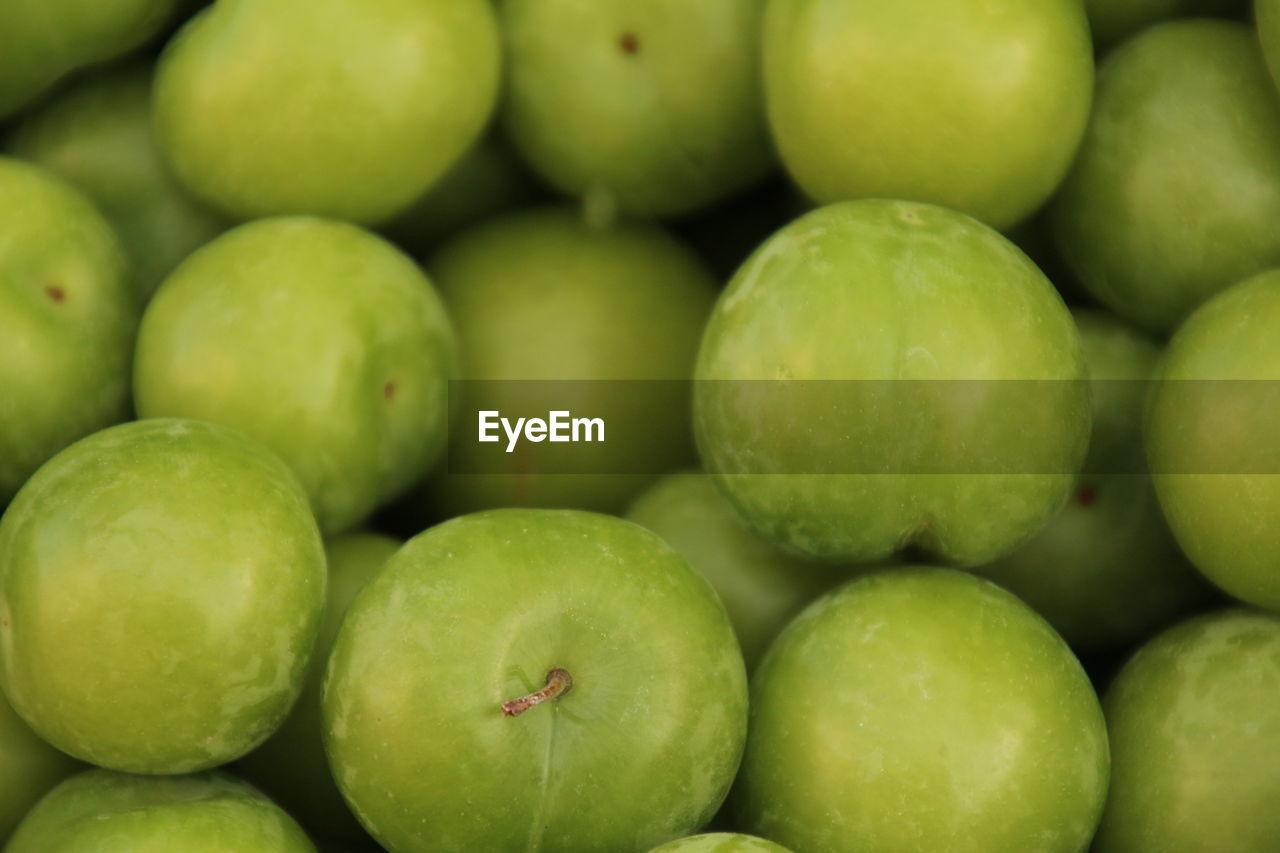 Full Frame Shot Of Granny Smith Apples For Sale At Market