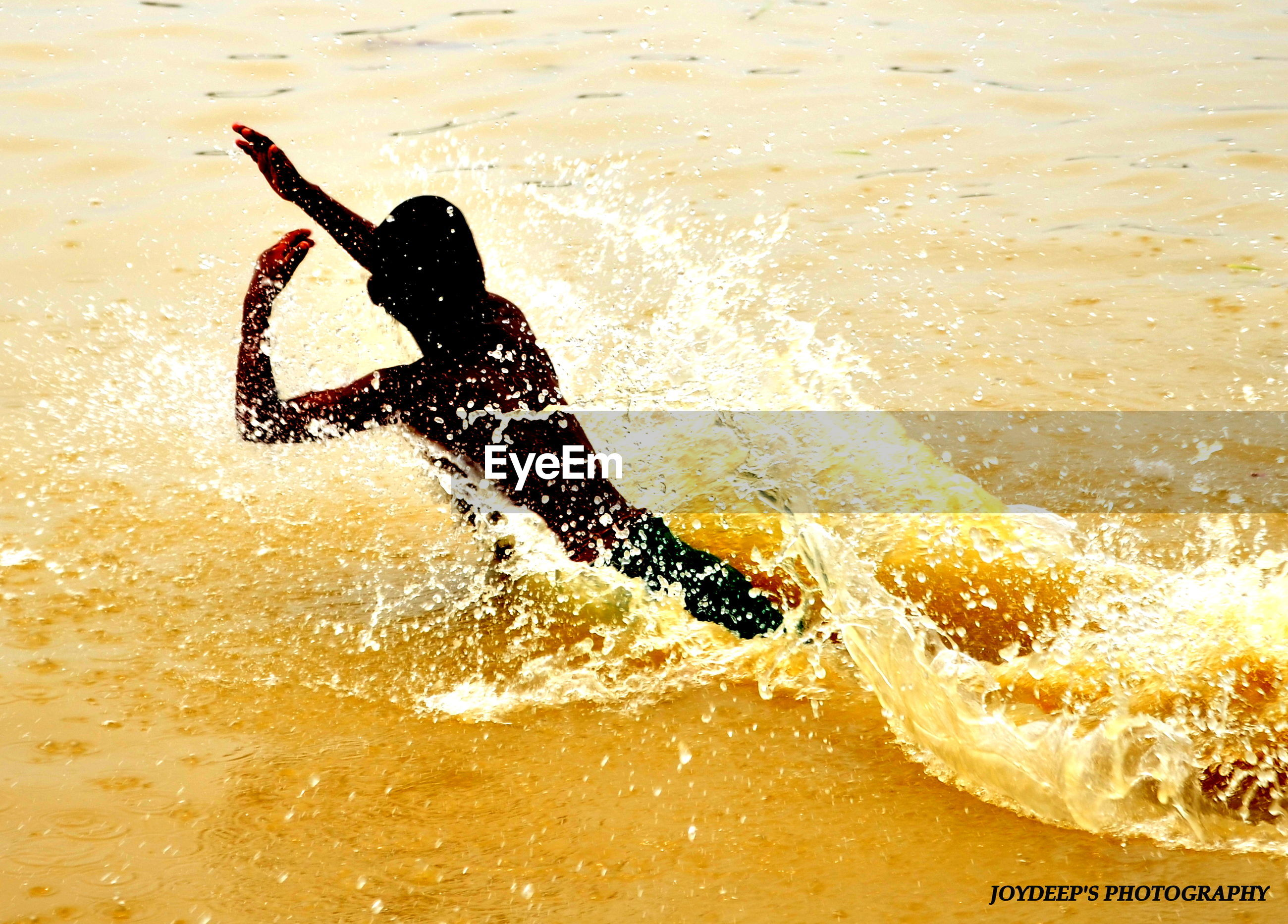 water, lifestyles, leisure activity, beach, sea, sand, men, shore, vacations, wave, surf, refreshment, person, surfboard, high angle view, sunlight, unrecognizable person, holding