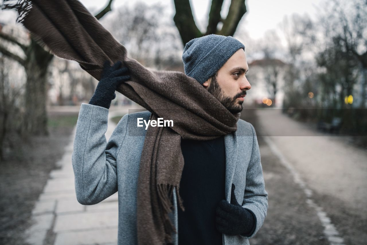 Close-Up Of Man Wearing Scarf At Park During Winter