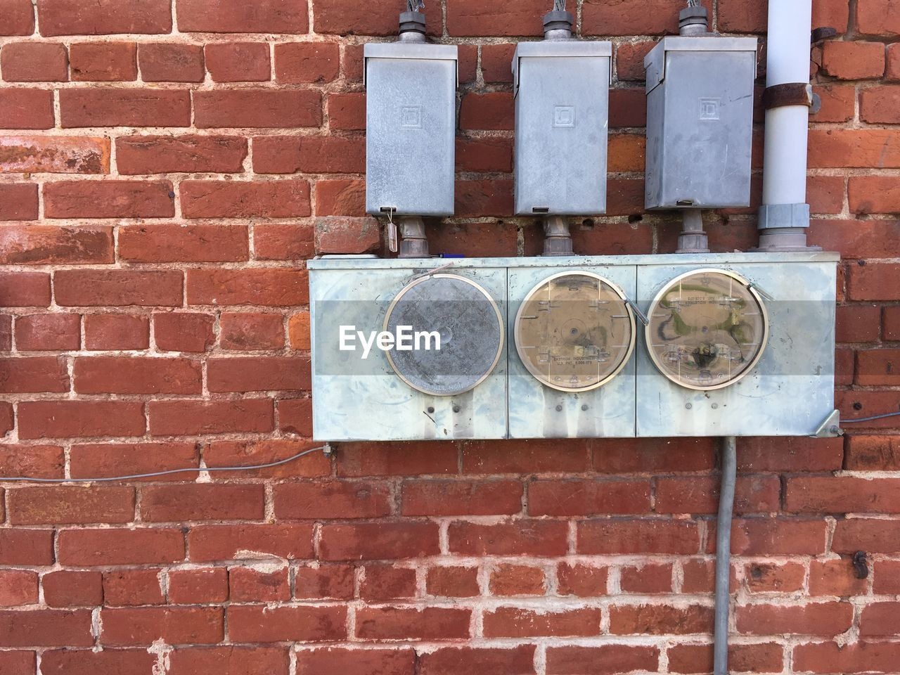 brick, brick wall, wall, wall - building feature, architecture, built structure, day, no people, pattern, side by side, outdoors, close-up, old, building exterior, electricity, geometric shape, metal, rusty, brown, connection