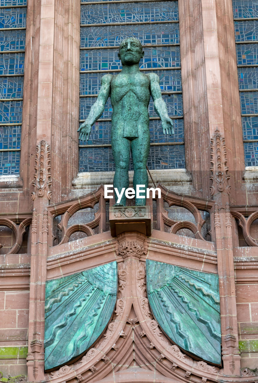 sculpture, representation, art and craft, architecture, human representation, statue, building exterior, no people, day, travel destinations, the past, built structure, history, male likeness, craft, creativity, low angle view, old, building, turquoise colored, ornate