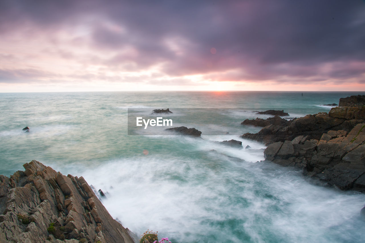 sea, water, sky, beauty in nature, scenics - nature, horizon over water, horizon, cloud - sky, motion, rock, beach, sunset, solid, nature, wave, rock - object, land, tranquil scene, no people, outdoors, power in nature, rocky coastline