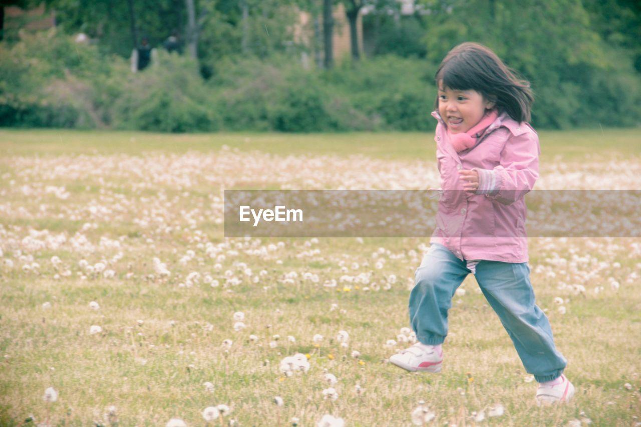 Cute girl running on field