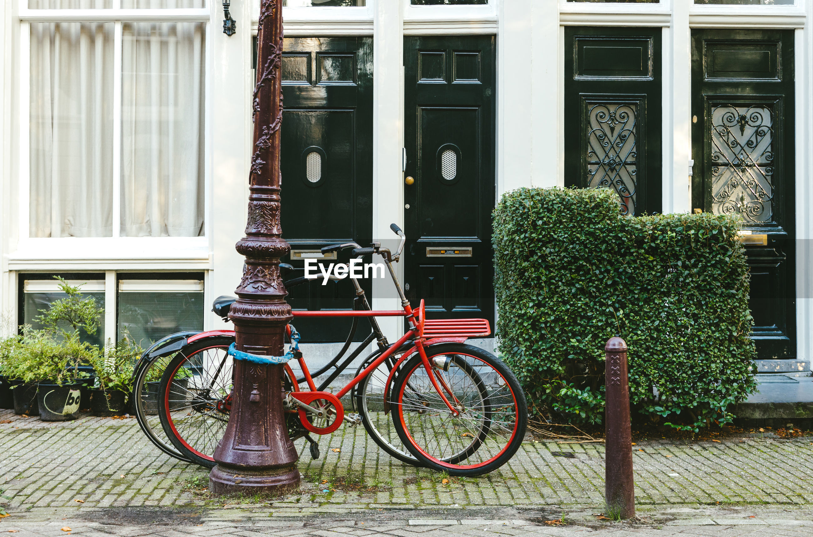 Bicycles parked against building