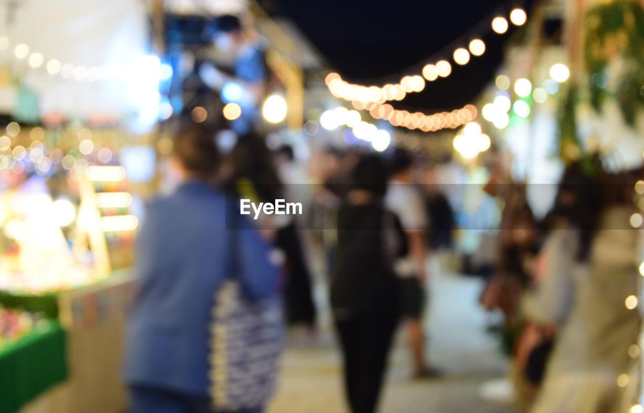 illuminated, night, lighting equipment, focus on foreground, celebration, hanging, outdoors, real people, christmas decoration, close-up