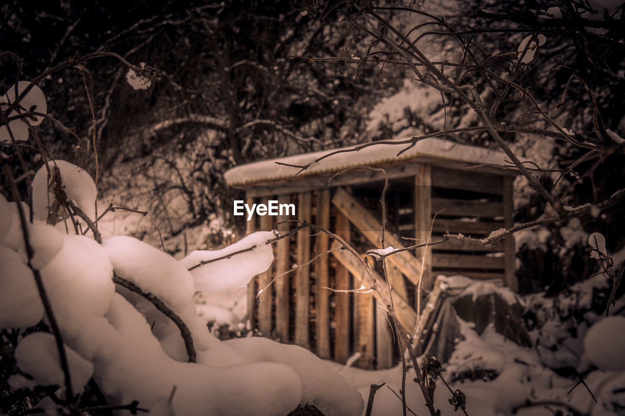 View of snow covered shed in winter
