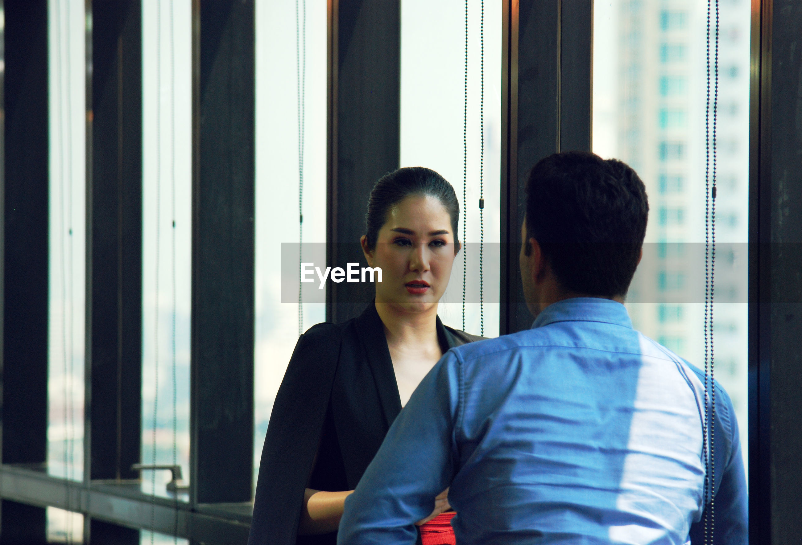 Businesswoman with male colleague in office during meeting