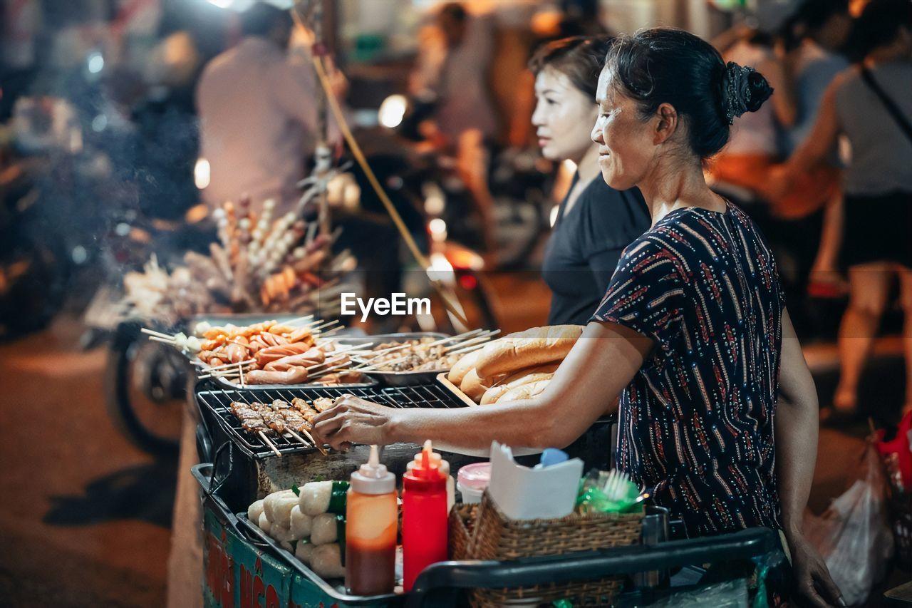 People having food at market stall