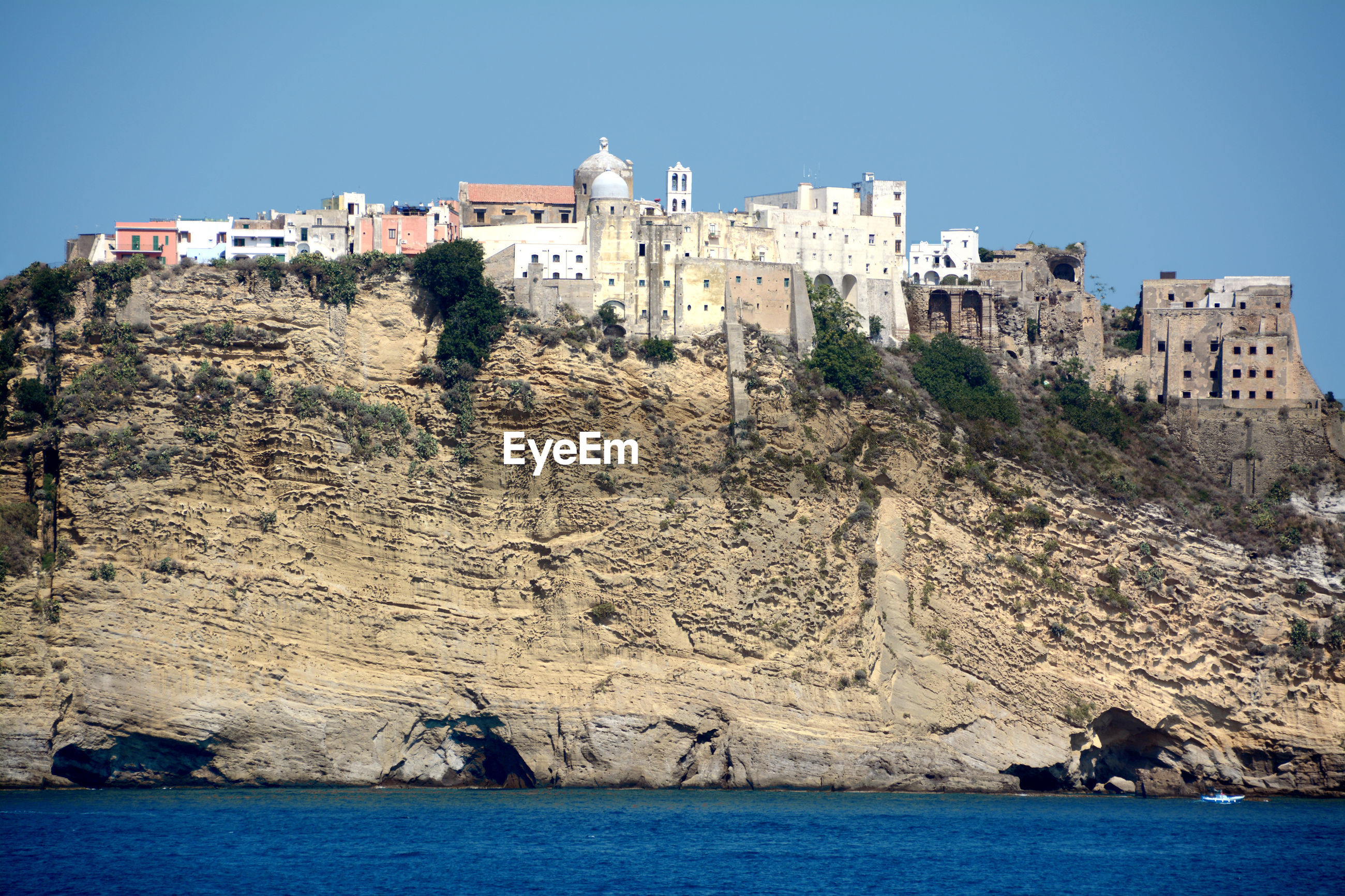 View of sea and buildings against sky