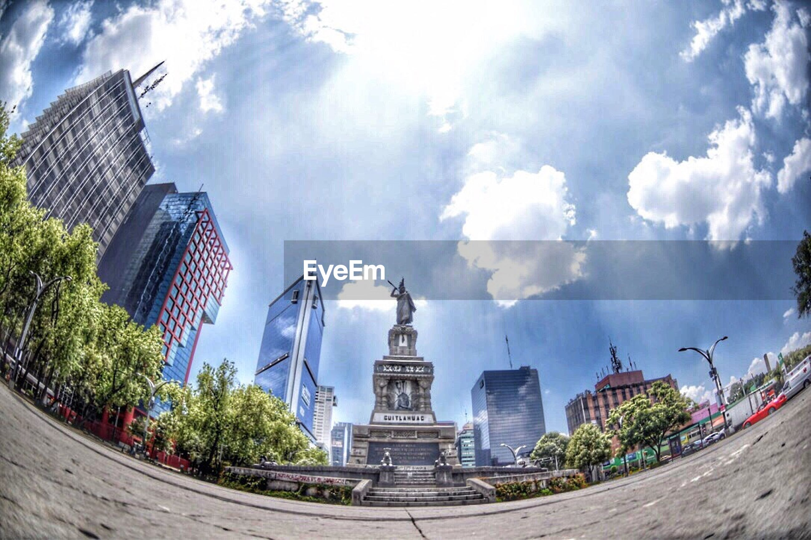 architecture, sky, cloud - sky, building exterior, statue, built structure, sculpture, no people, outdoors, day, fish-eye lens, tree, city