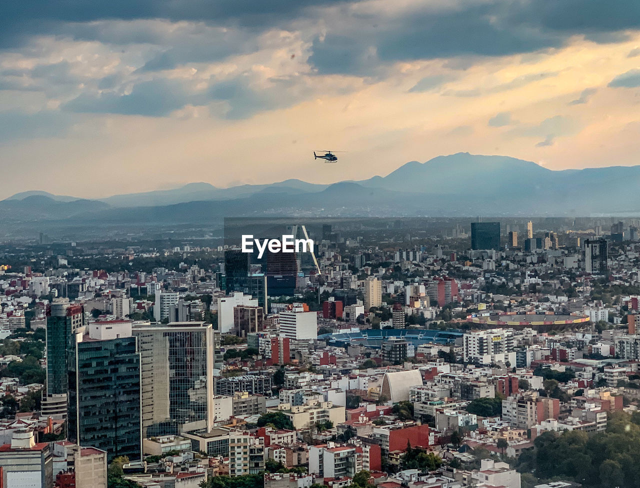 Aerial view of buildings in mexico city against sky