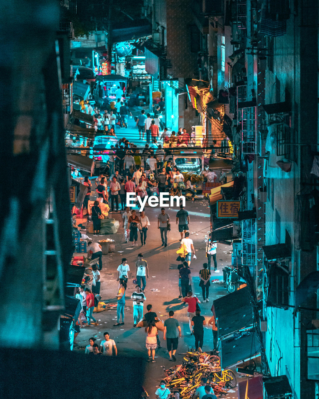 High Angle View Of People On Street At Night