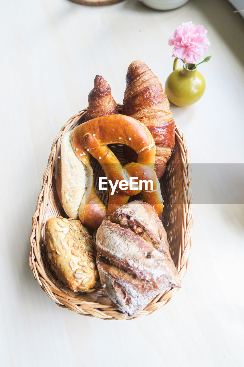 food and drink, food, freshness, still life, indoors, basket, table, close-up, bread, no people, high angle view, container, healthy eating, ready-to-eat, baked, wicker, wellbeing, fruit, focus on foreground, bun, french food, temptation
