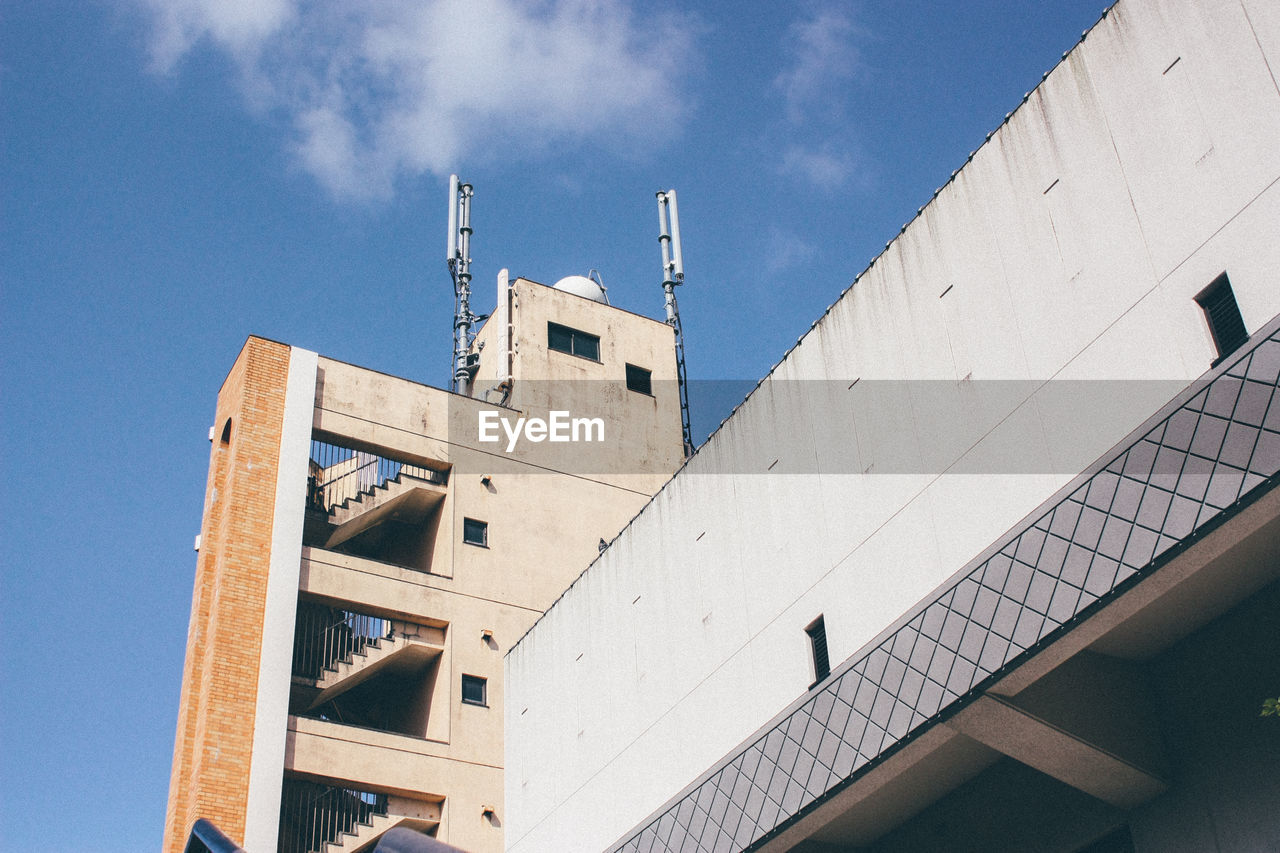 Low angle view of building against sky on sunny day