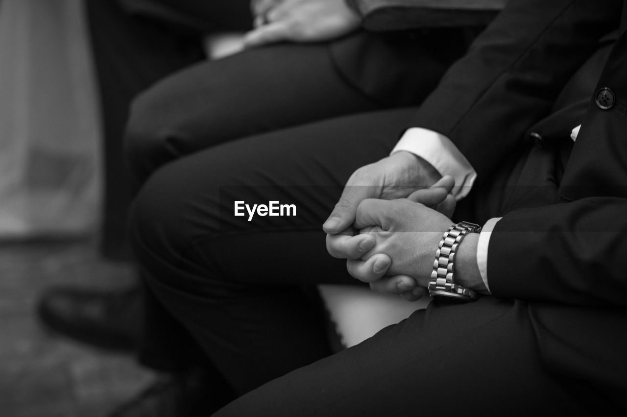 real people, hand, adult, midsection, human hand, women, sitting, people, human body part, men, togetherness, beginnings, focus on foreground, bonding, pregnant, anticipation, lifestyles, two people, jewelry, body part, positive emotion, couple - relationship, care, finger