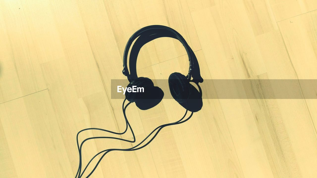 High Angle View Of Headphones On Floorboard