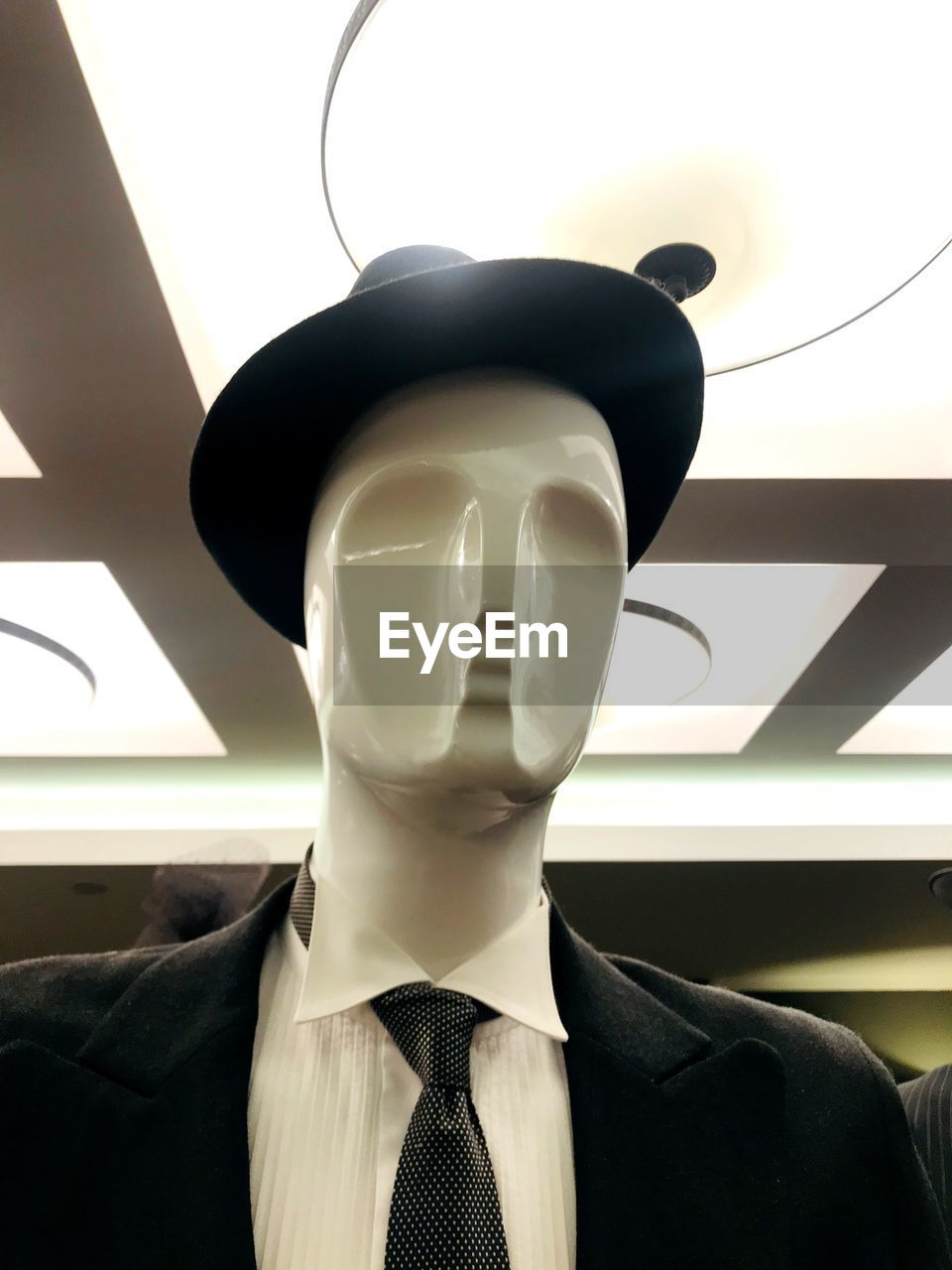 mannequin, human representation, representation, store, indoors, menswear, retail, male likeness, necktie, shopping, retail display, female likeness, clothing, business, no people, well-dressed, window, clothing store, fashion, store window, consumerism, dressmaker's model