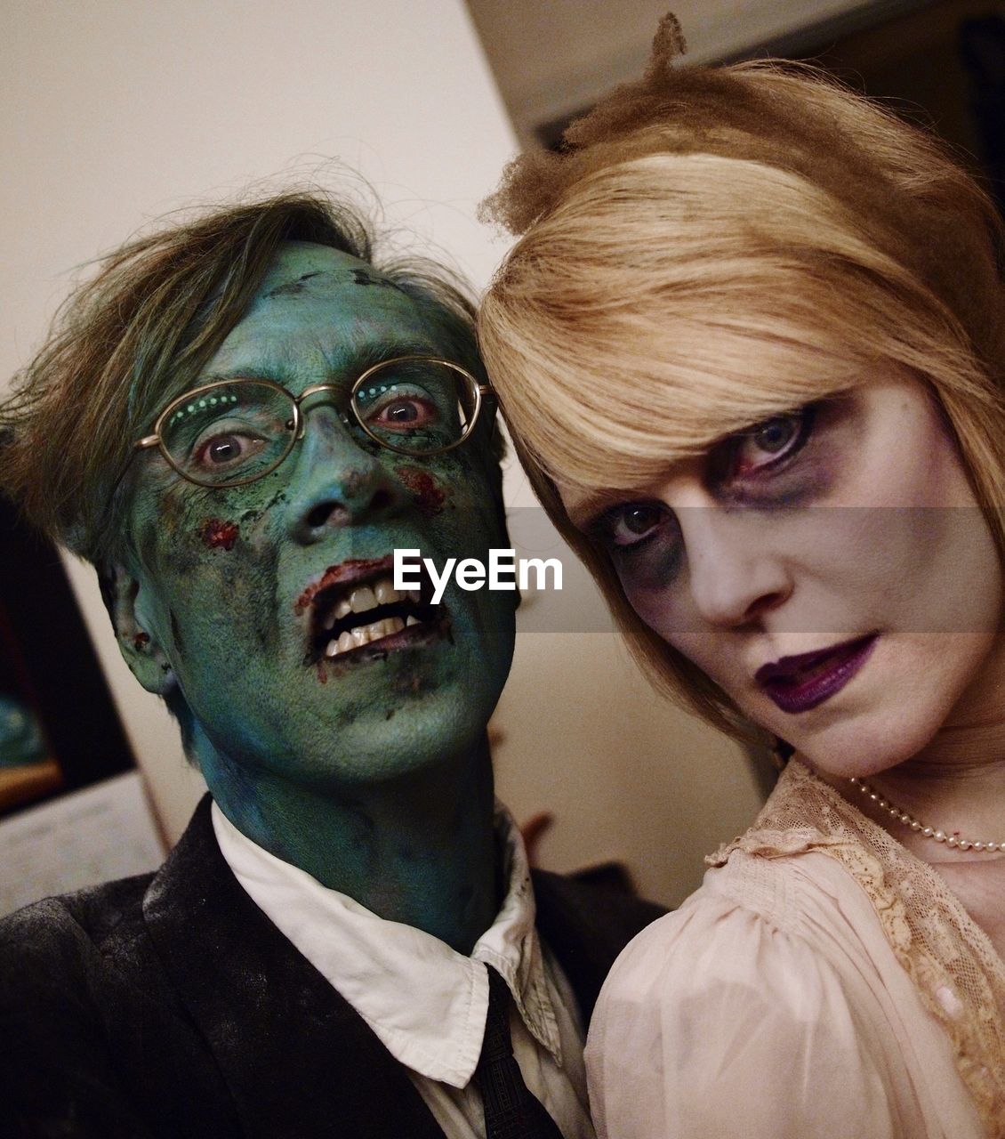 Close-Up Portrait Of Spooky Couple During Halloween