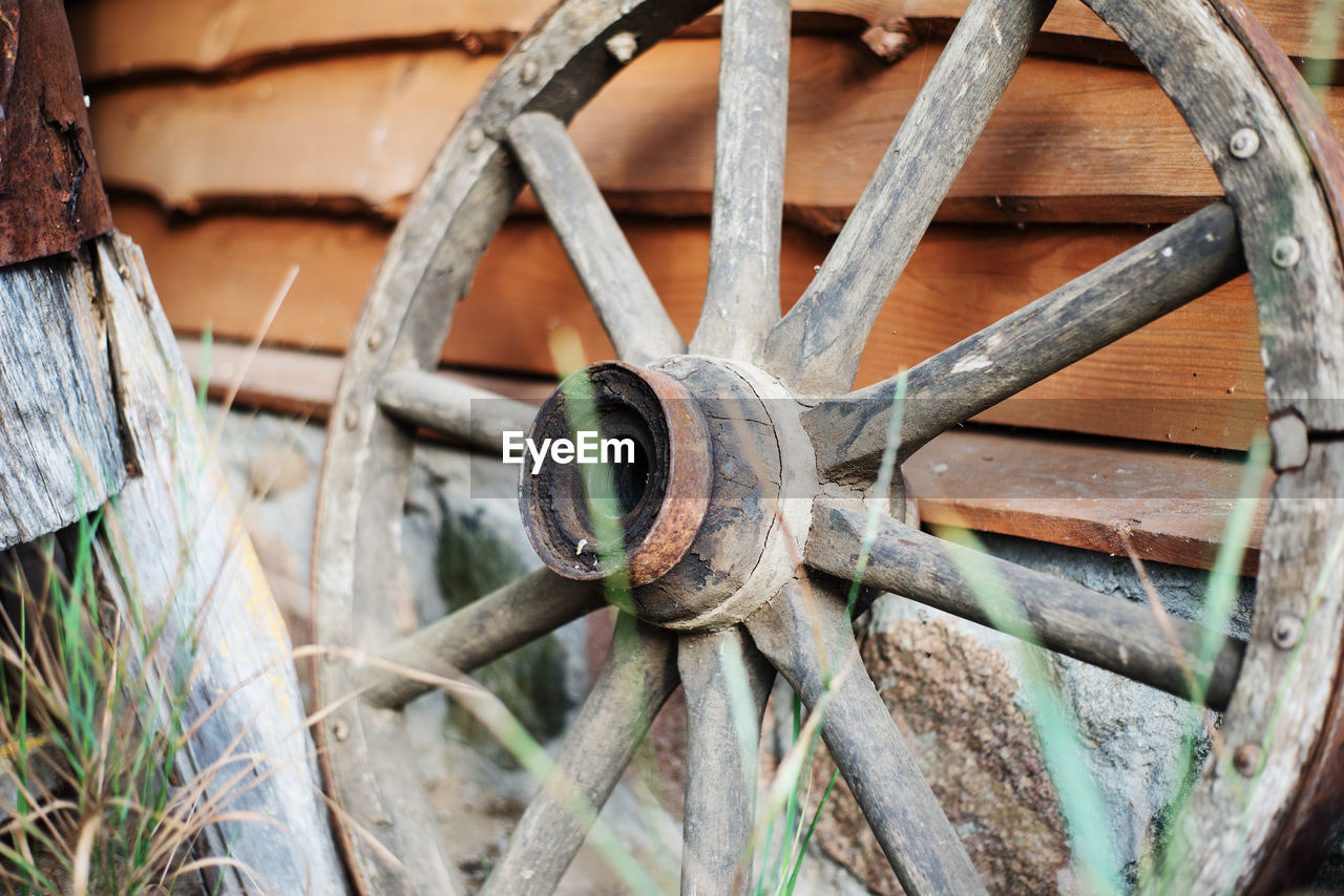 Close-Up Of Rusty Wagon Wheel On Wall