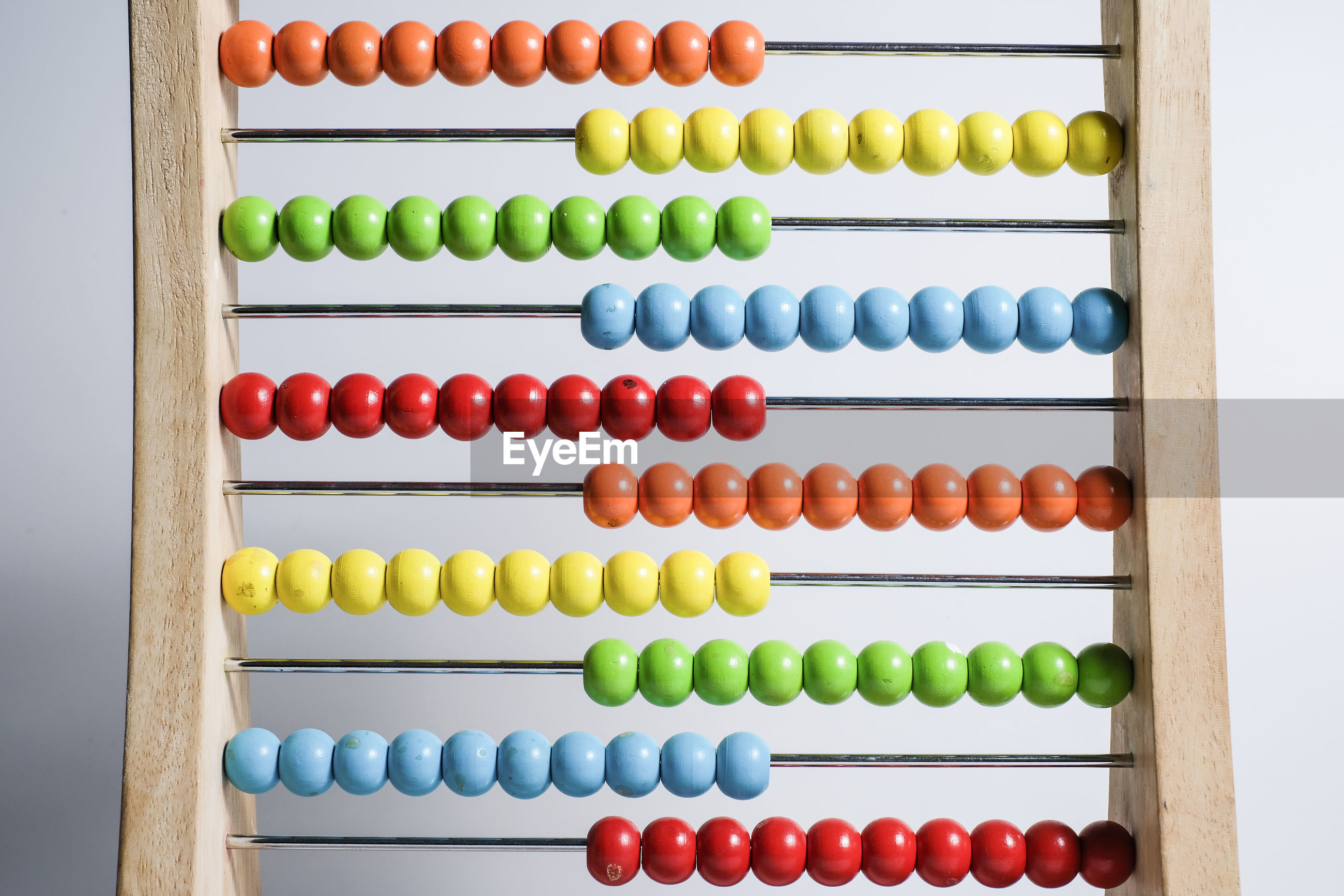 Close-up of multi colored abacus against blue background