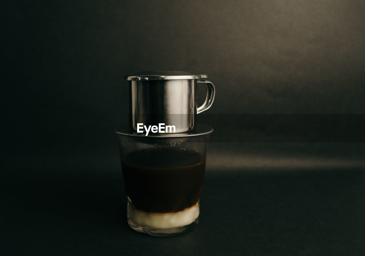 food and drink, drink, refreshment, still life, indoors, studio shot, glass, coffee, no people, close-up, household equipment, table, drinking glass, coffee - drink, freshness, focus on foreground, glass - material, transparent, metal, mug, black background, crockery