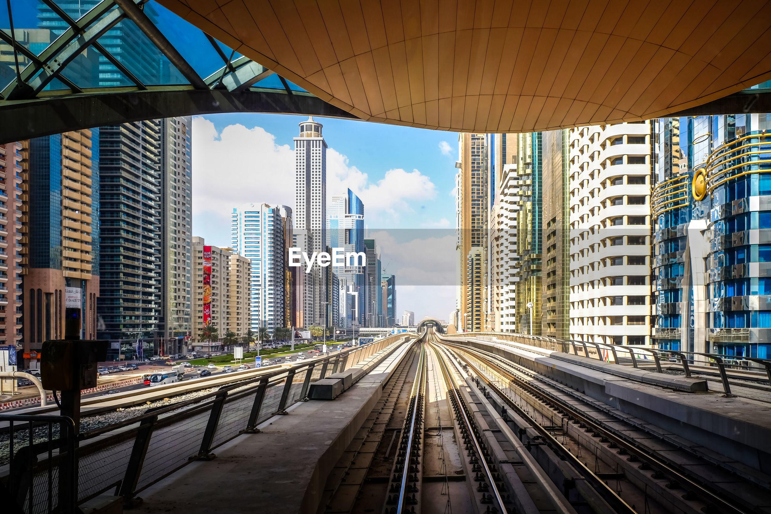 Railroad tracks passing through city buildings