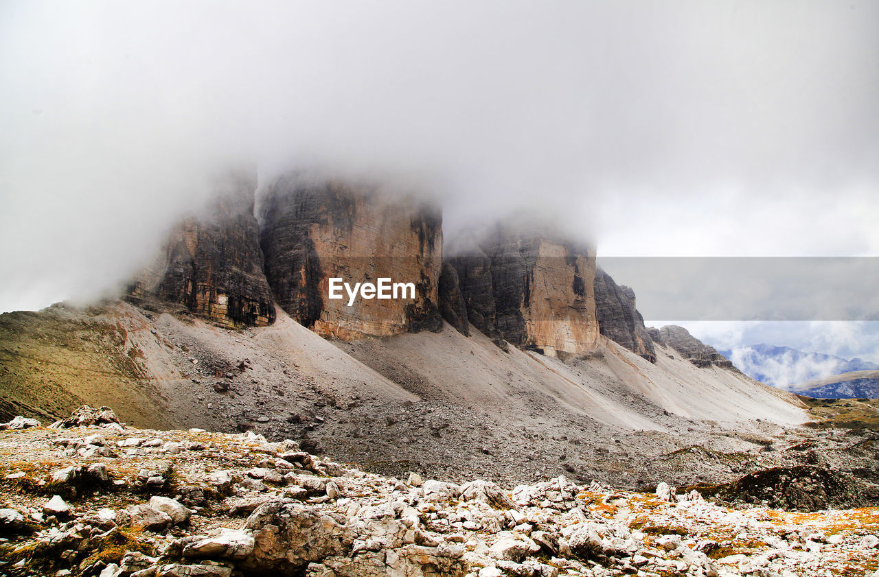 Scenic View Of Dolomites Against Cloudy Sky
