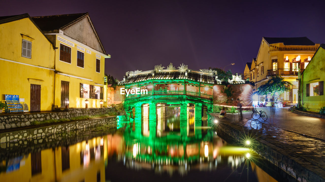 architecture, building exterior, built structure, night, illuminated, water, long exposure, sky, outdoors, reflection, no people, waterfront, travel destinations, residential building, city, motion