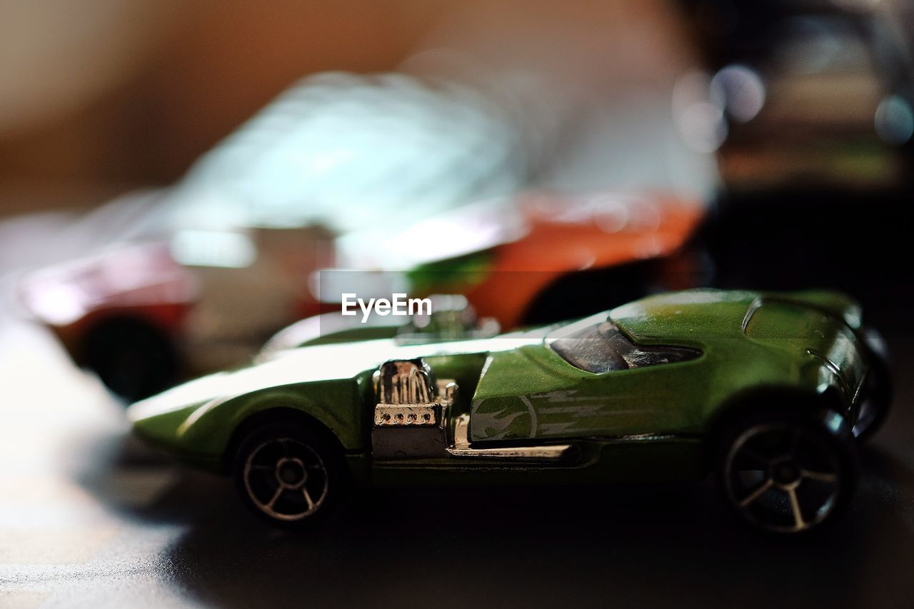 toy car, selective focus, no people, close-up, indoors, technology, day