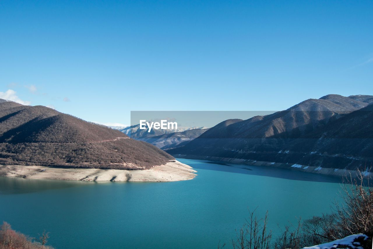 nature, mountain, beauty in nature, scenics, tranquil scene, tranquility, water, blue, lake, no people, outdoors, day, clear sky, sky