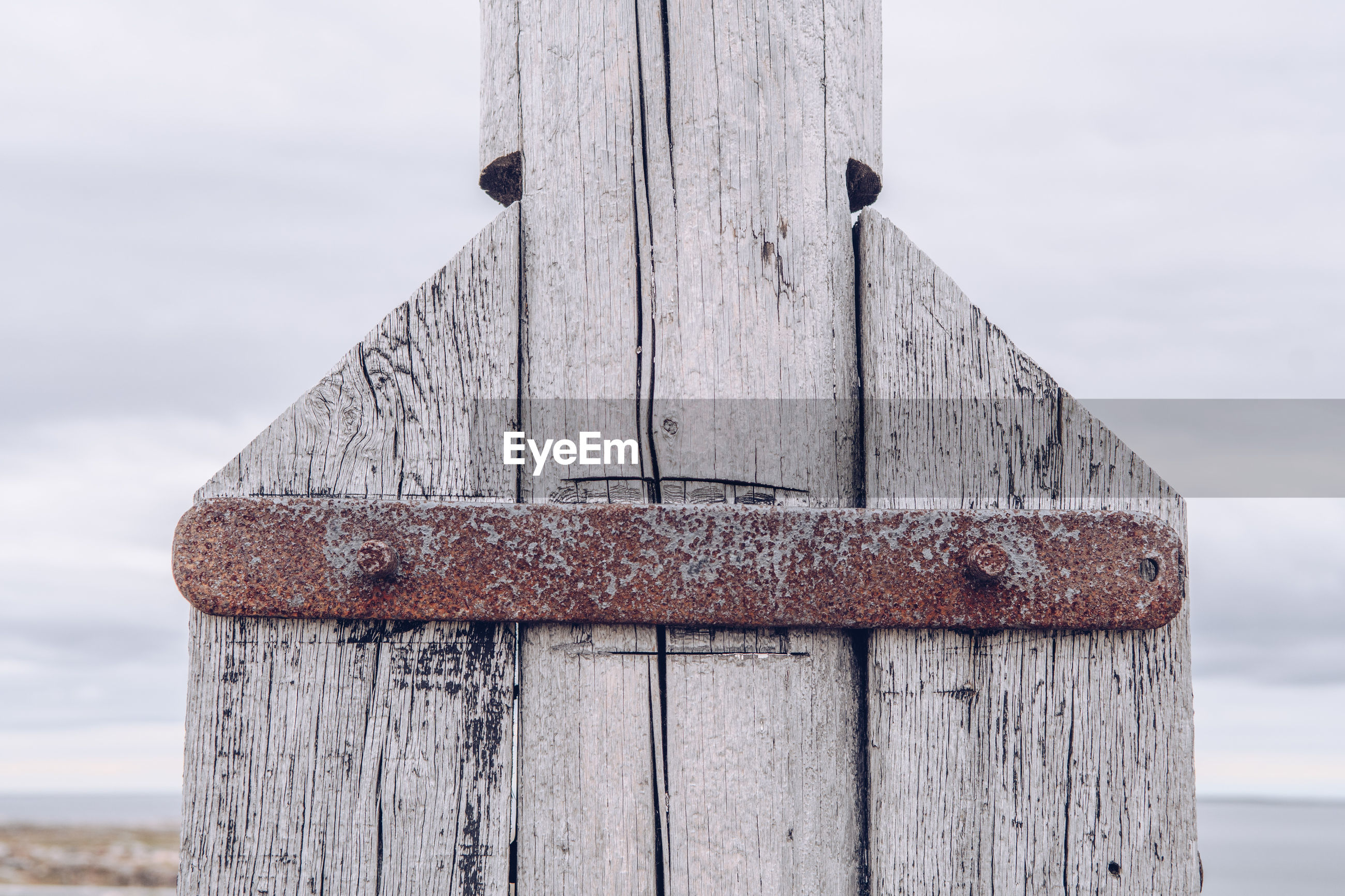 Close-up of wooden built structure against sky