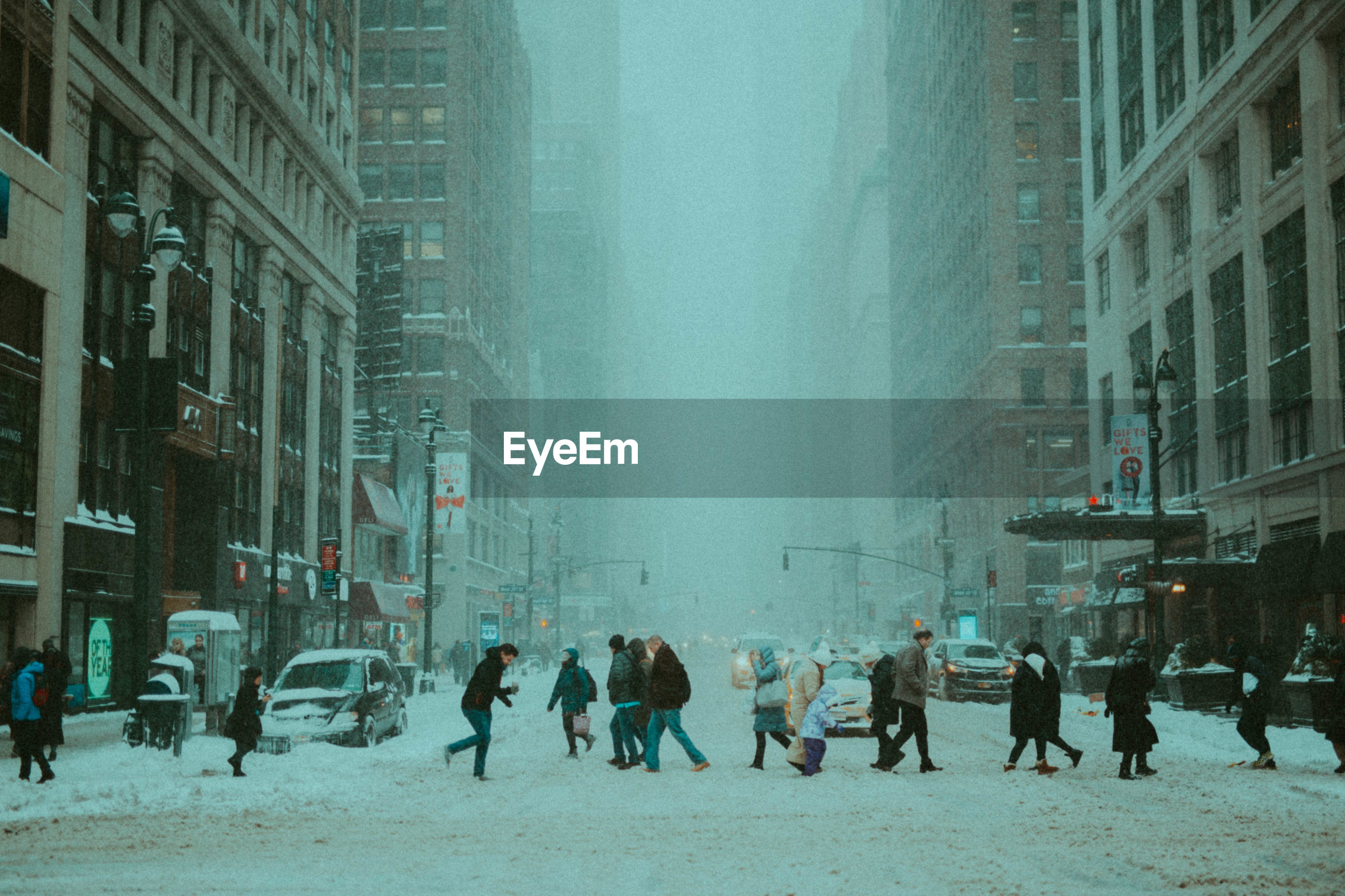 GROUP OF PEOPLE IN CITY DURING WINTER