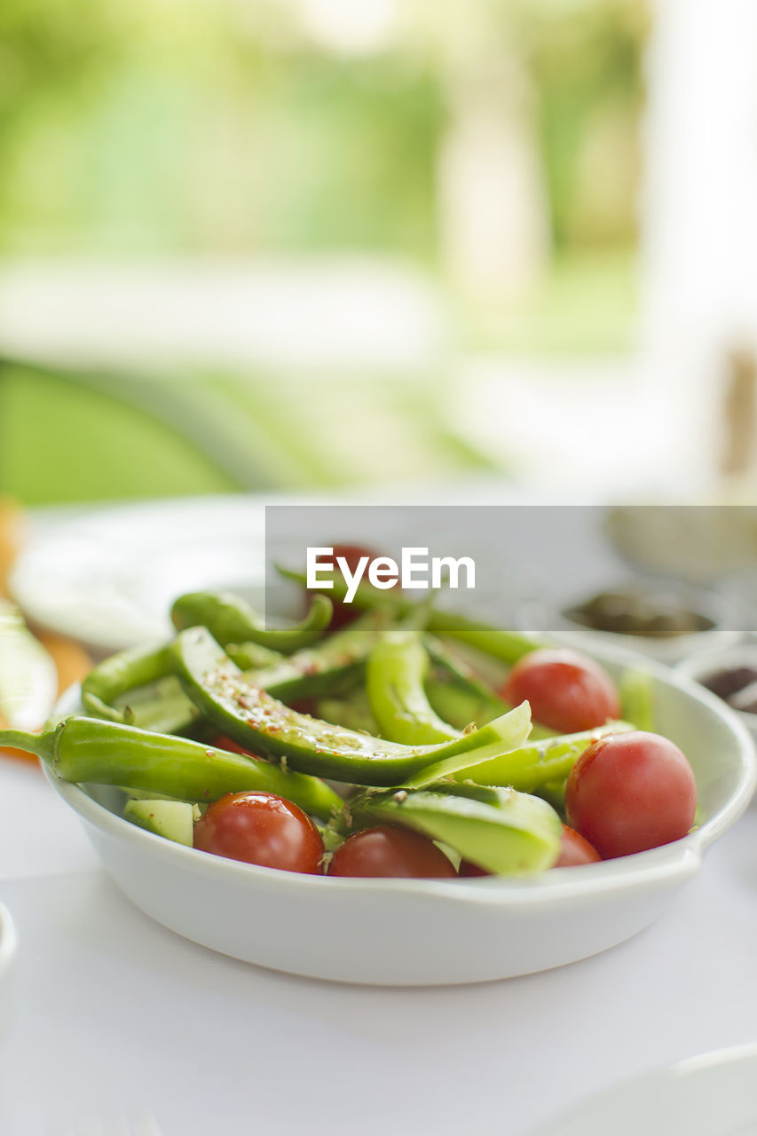 food and drink, food, healthy eating, wellbeing, freshness, vegetable, tomato, table, no people, fruit, still life, green color, close-up, plate, focus on foreground, indoors, bowl, ready-to-eat, salad, selective focus, vegetarian food, snack, crockery