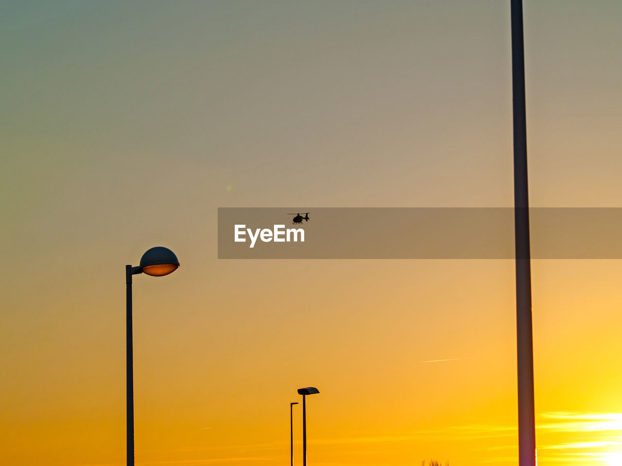 sunset, street light, nature, no people, transportation, flying, beauty in nature, outdoors, sky, technology, day