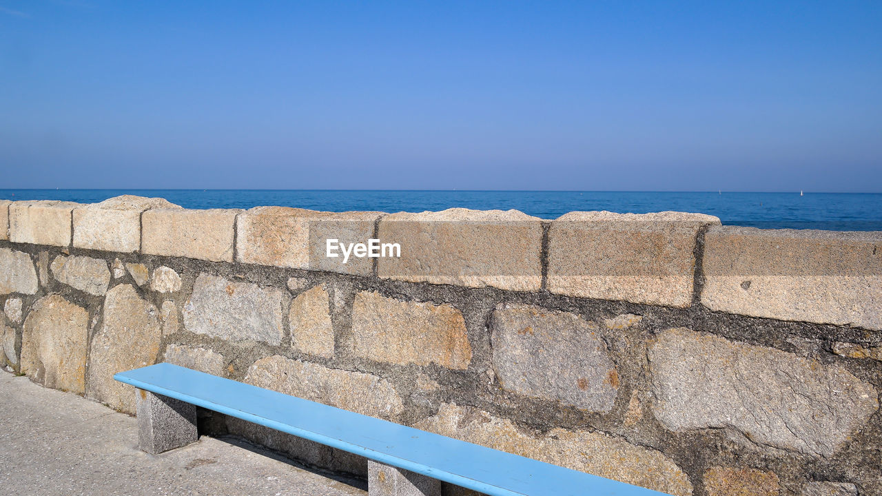 sky, sea, water, wall, nature, blue, no people, horizon over water, day, sunlight, copy space, retaining wall, architecture, clear sky, built structure, wall - building feature, horizon, outdoors, tranquility, stone wall, concrete