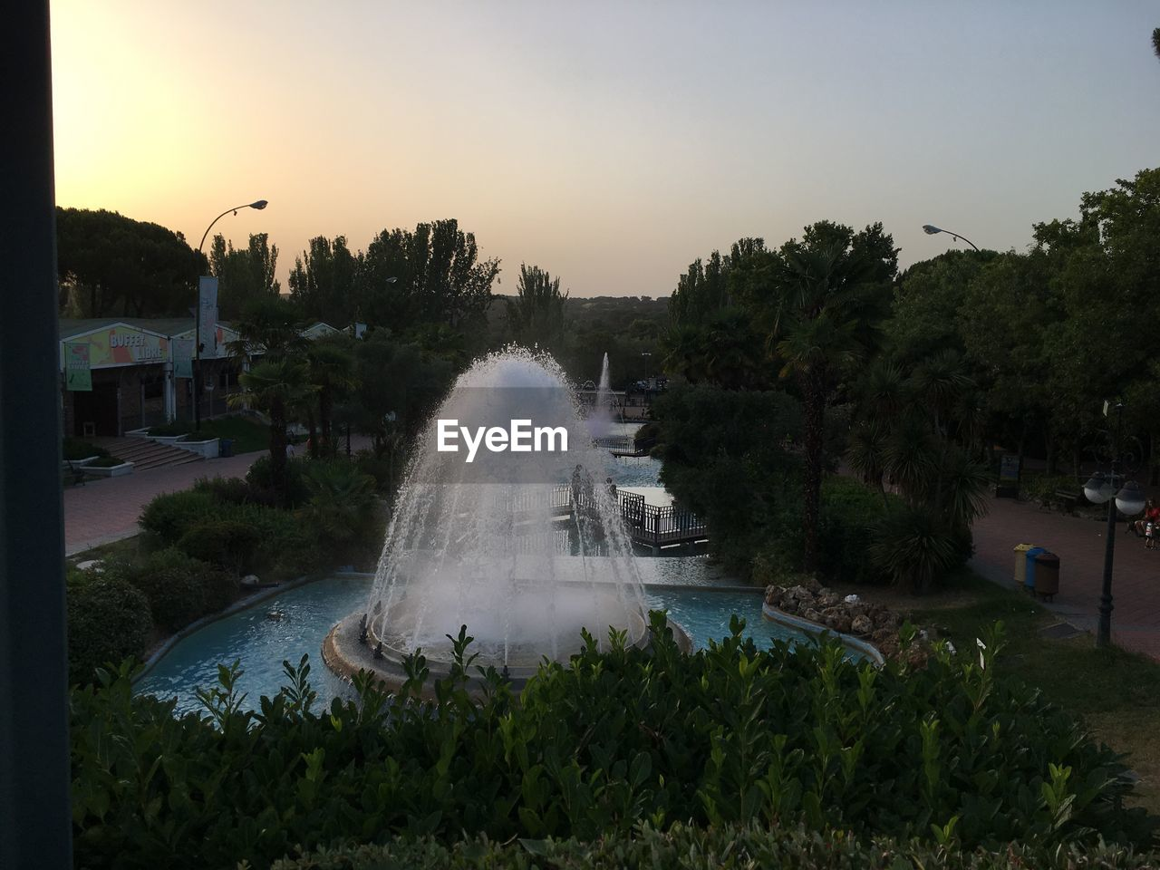 sky, tree, water, plant, architecture, sunset, built structure, nature, motion, building exterior, fountain, city, spraying, park, no people, park - man made space, growth, travel, day