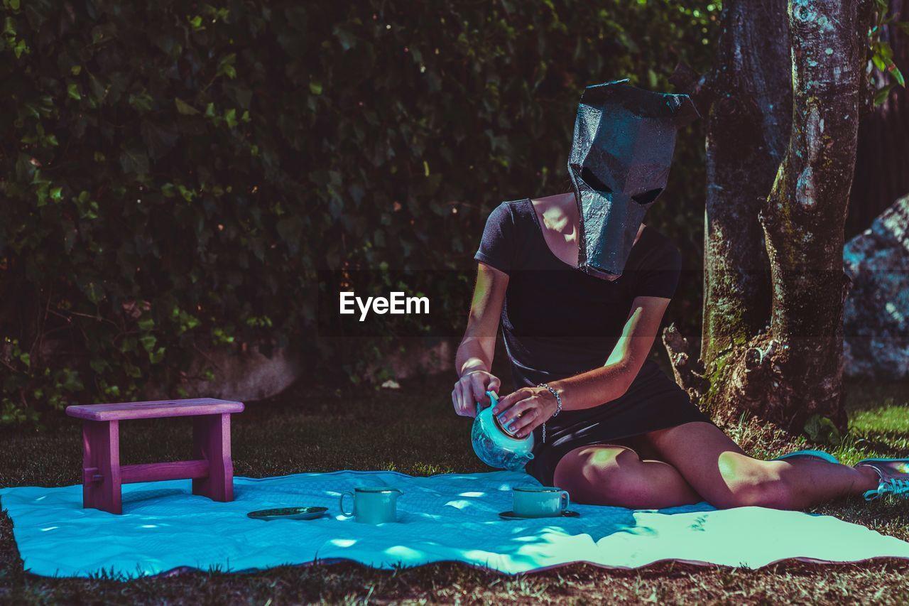Woman Wearing Mask At Picnic