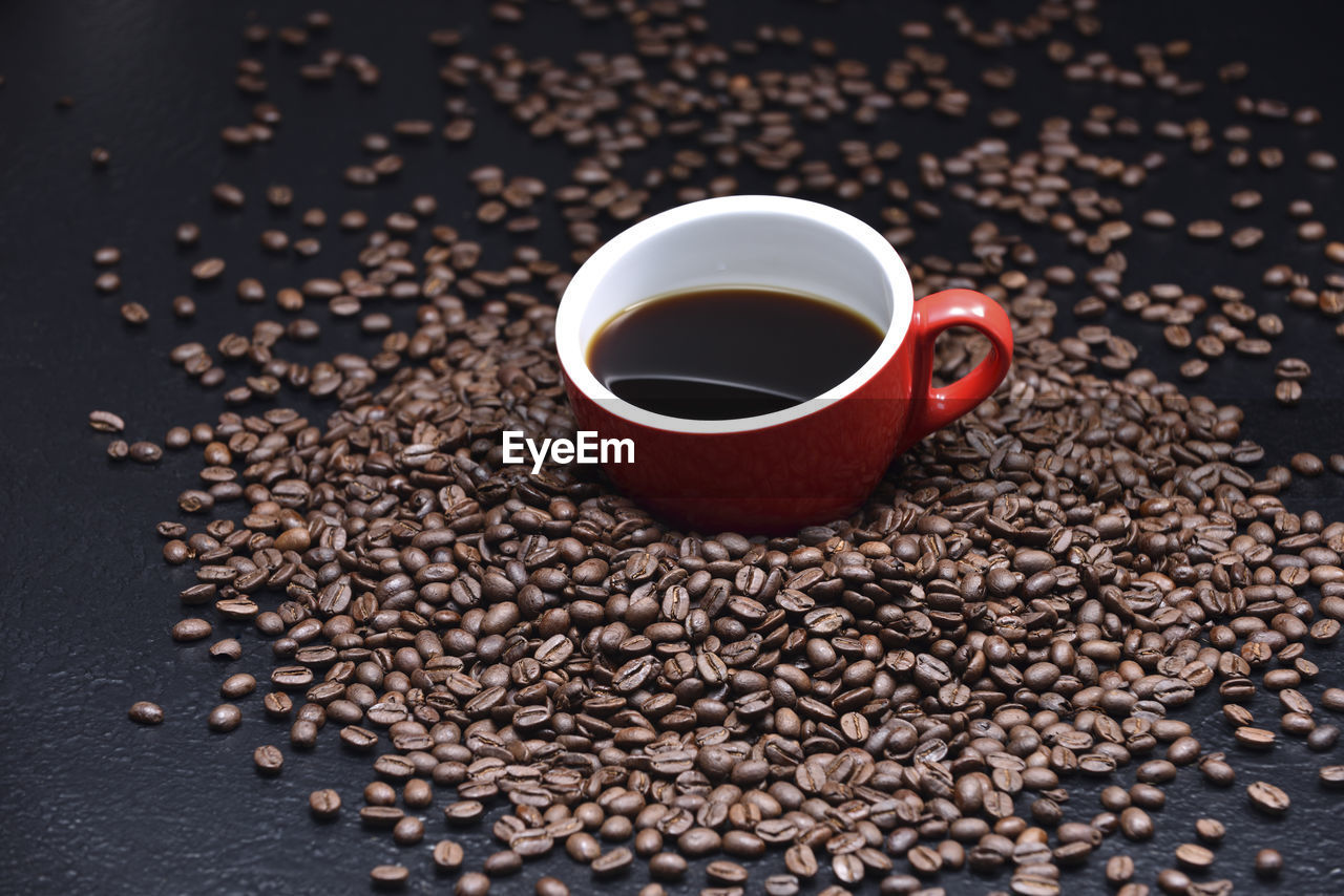 food and drink, drink, refreshment, cup, coffee, coffee - drink, mug, freshness, coffee cup, roasted coffee bean, food, indoors, no people, table, black coffee, still life, brown, high angle view, close-up, abundance, non-alcoholic beverage, crockery, caffeine, black tea