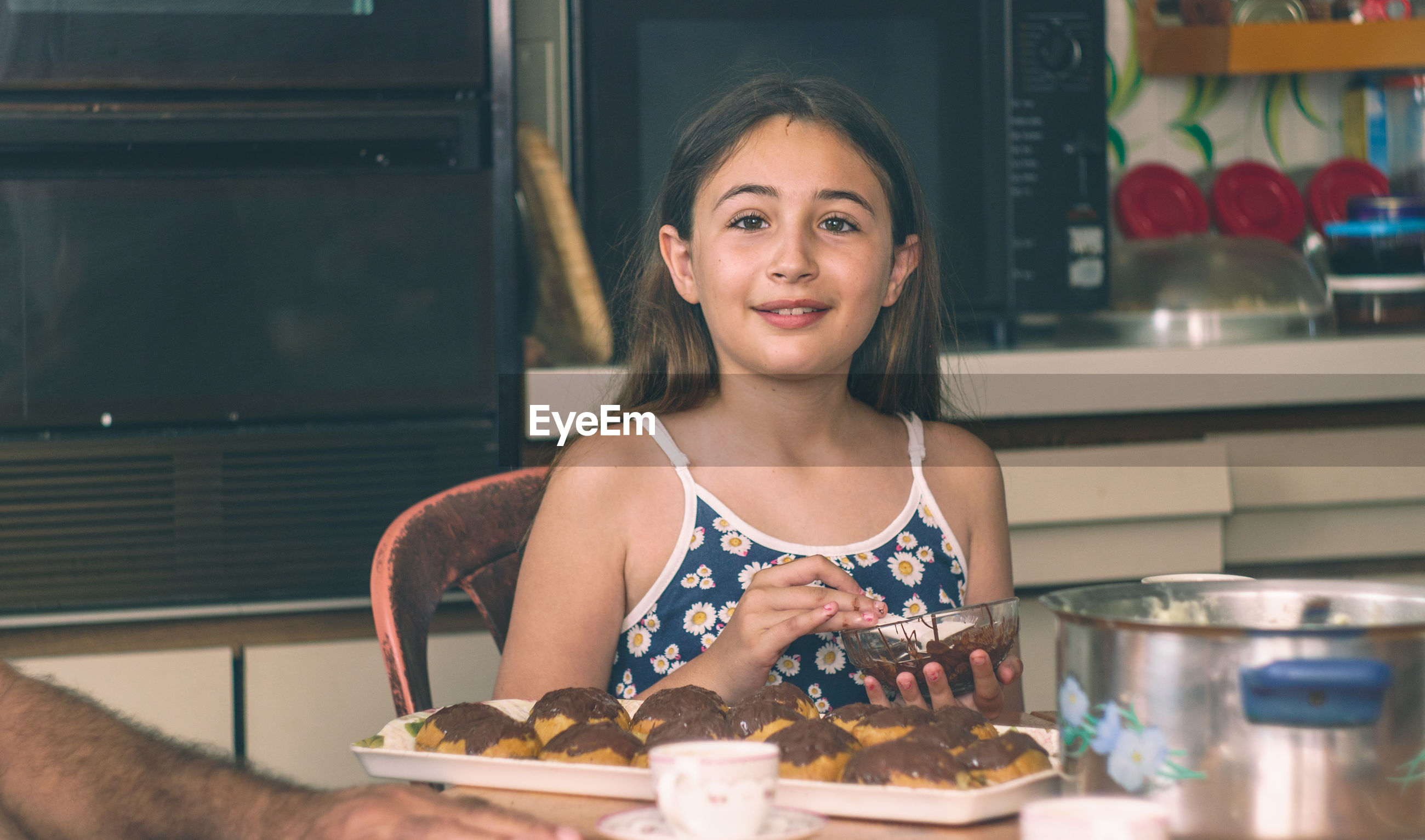 Portrait of girl preparing sweet food in kitchen at home