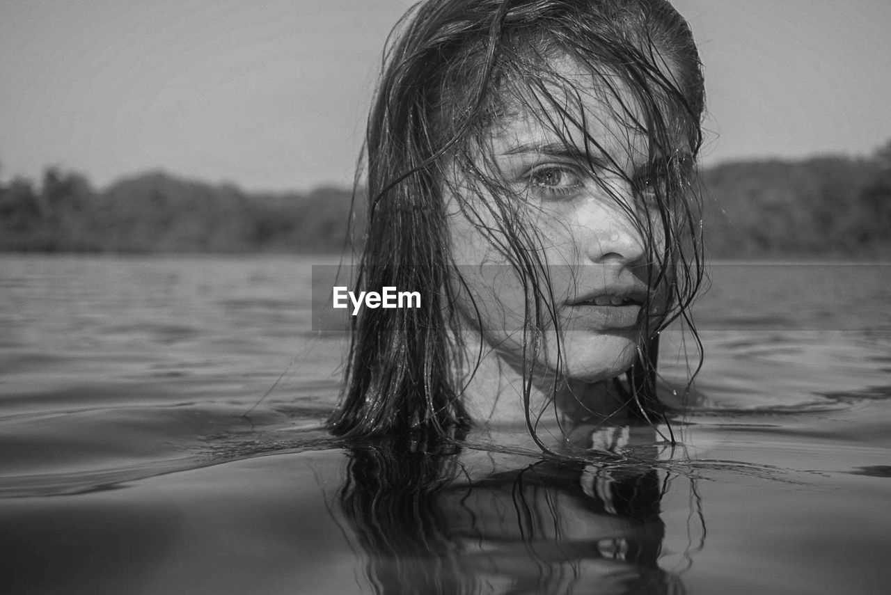 Portrait of woman swimming in lake