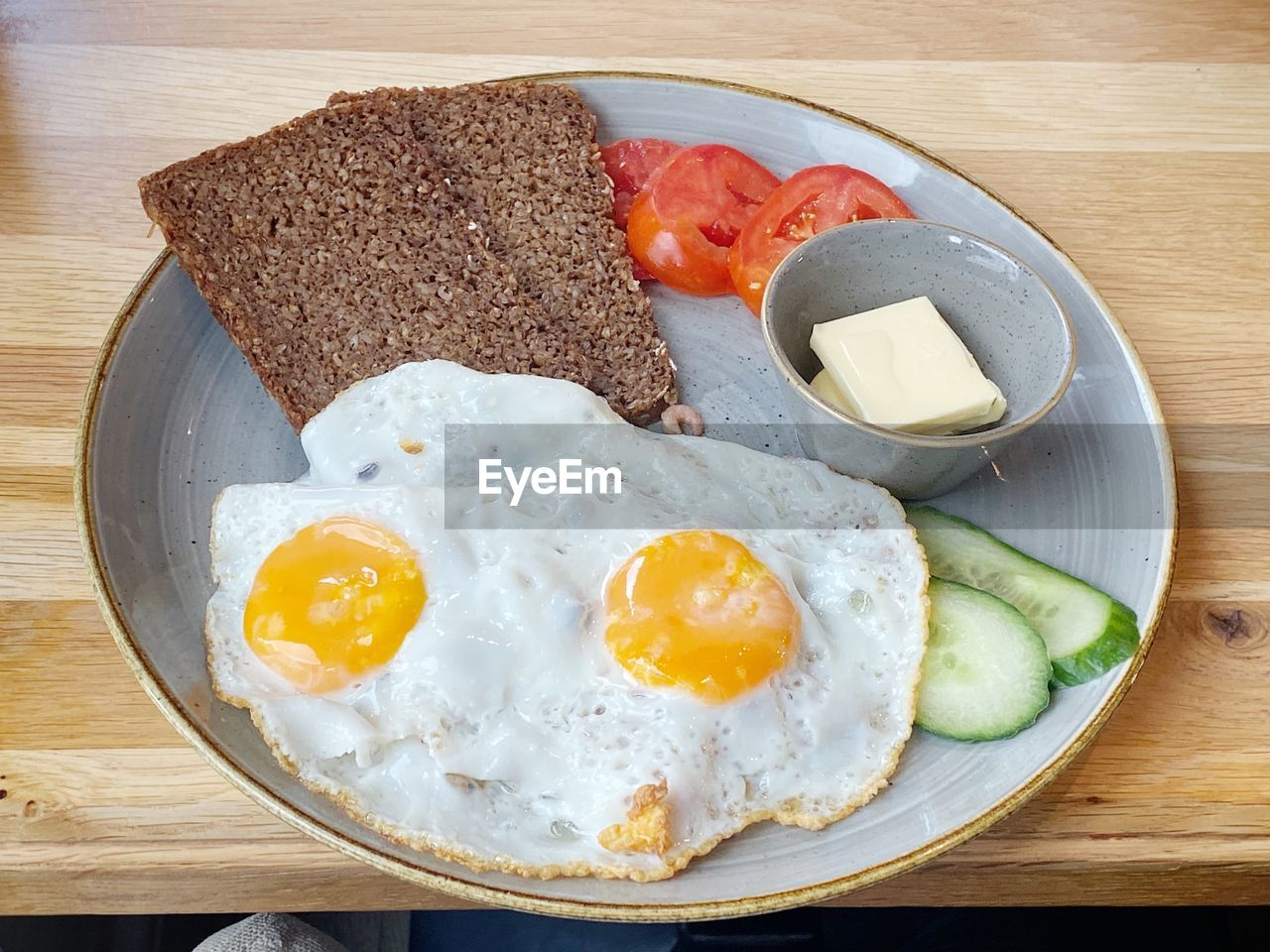 egg, food, food and drink, fried egg, breakfast, fried, ready-to-eat, meal, healthy eating, table, freshness, bread, still life, indoors, wellbeing, no people, egg yolk, directly above, high angle view, wood - material, sunny side up