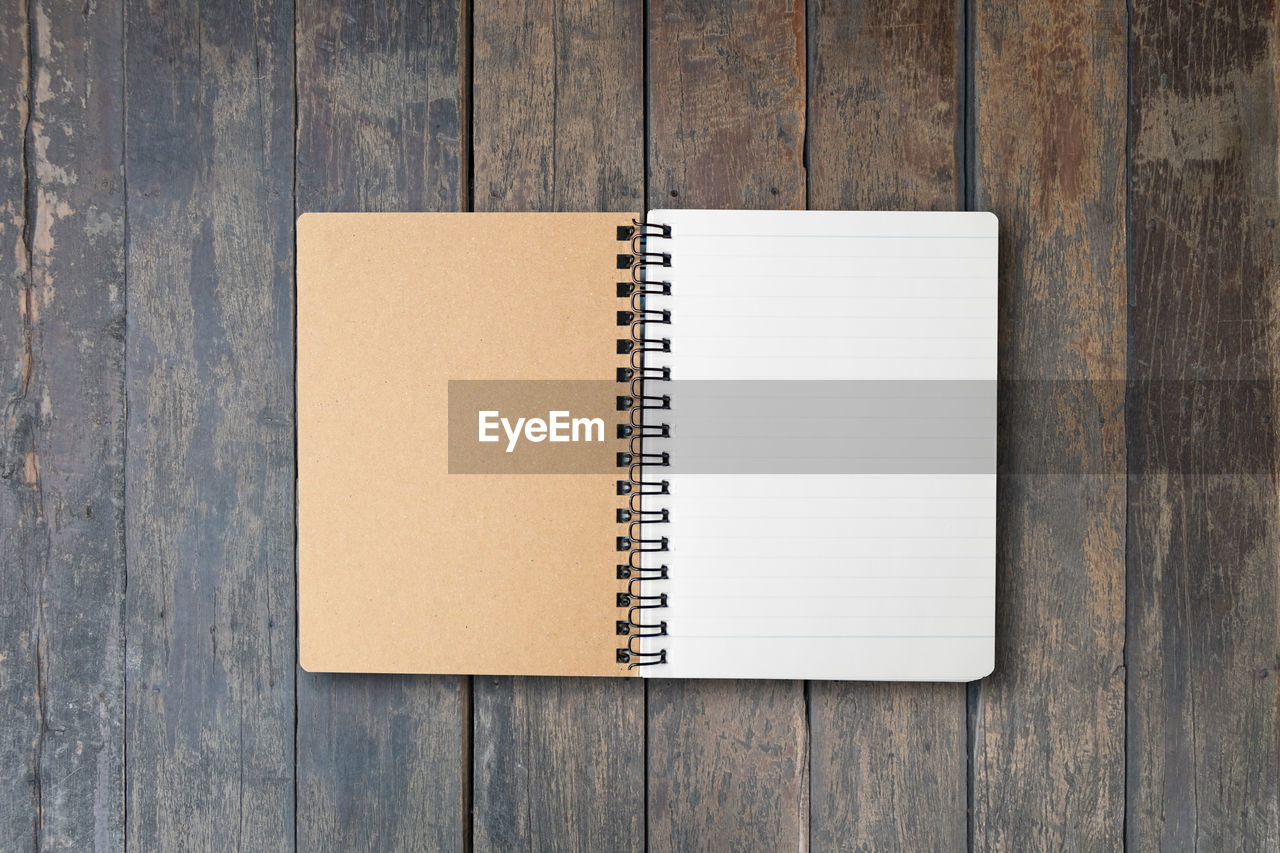 wood - material, note pad, copy space, publication, book, blank, table, paper, no people, indoors, spiral notebook, education, still life, high angle view, spiral, page, open, directly above, close-up, brown, wood grain