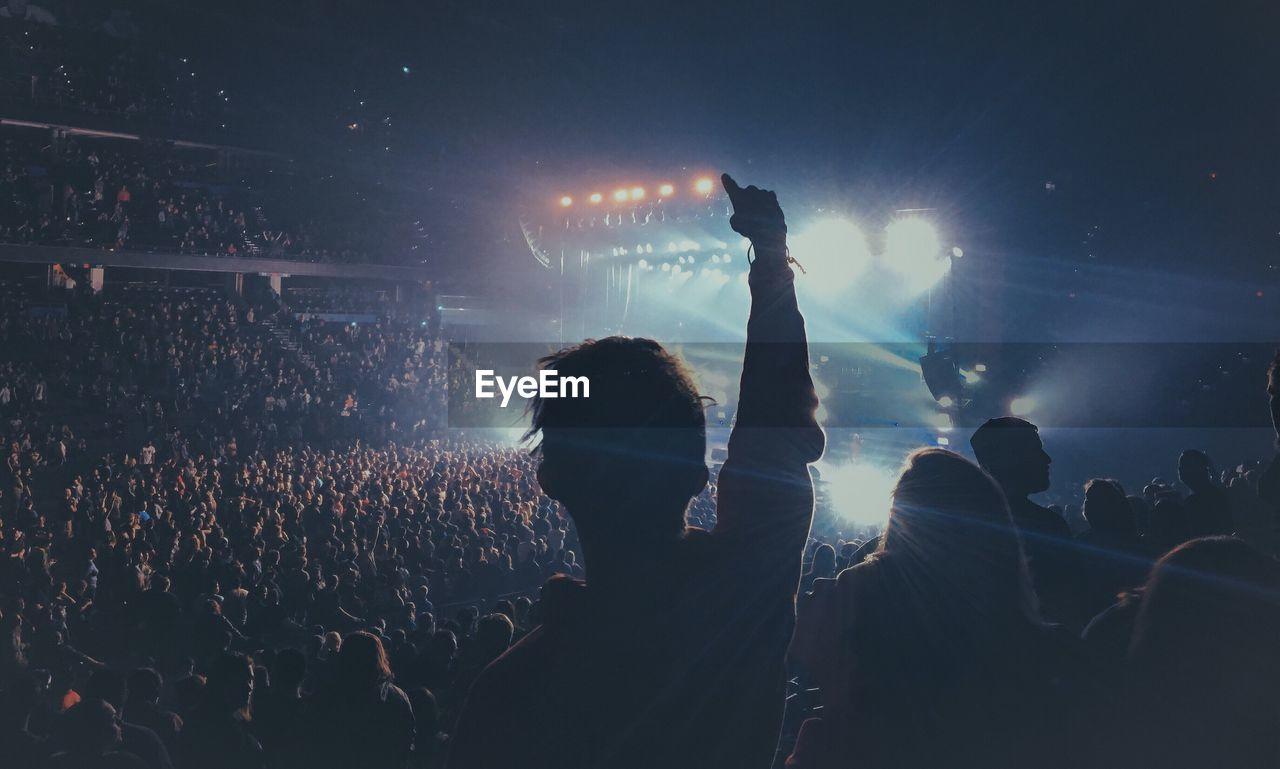 Silhouette Crowd Enjoying During Concert At Night