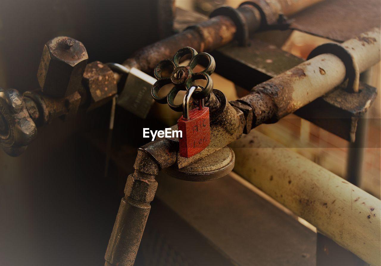 Close-up of padlocks on valve