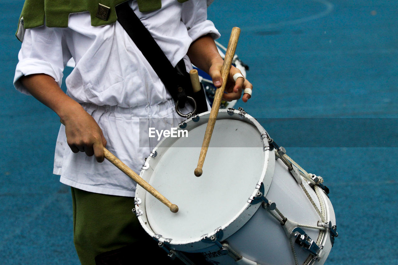 Low Section Of Man Playing Drum
