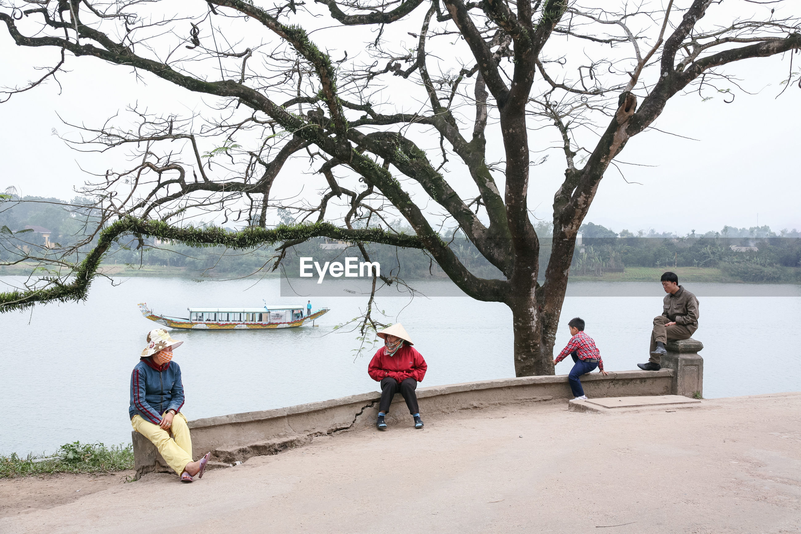 tree, men, branch, leisure activity, women, outdoors, real people, day, nature, water, occupation, sky, people, adult, adults only