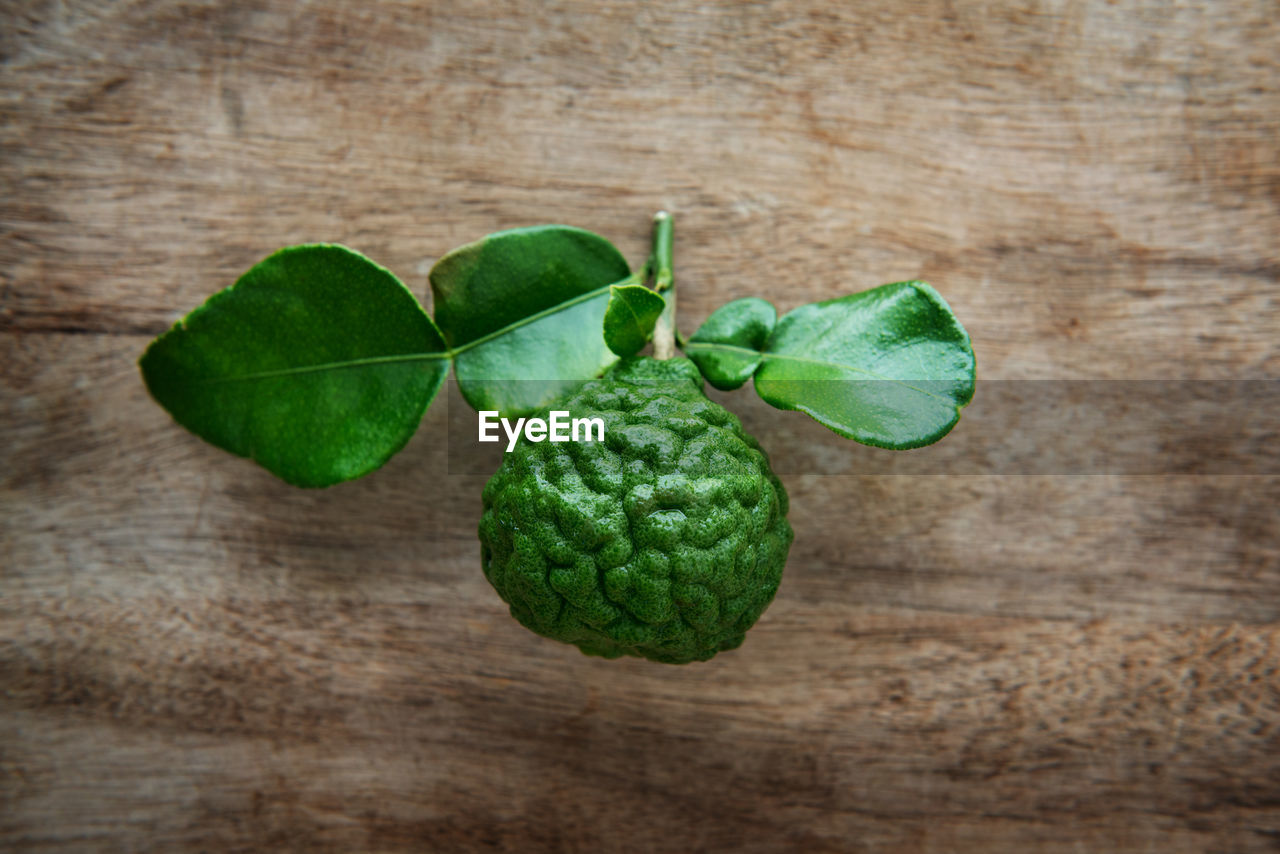 Close-up of kaffir lime on wooden table
