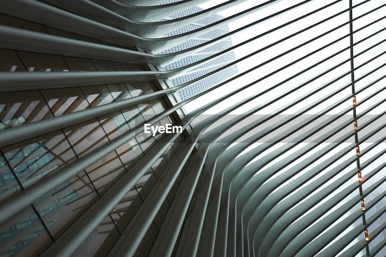 architecture, built structure, pattern, no people, low angle view, modern, indoors, day, full frame, backgrounds, building, metal, glass - material, sunlight, close-up, city, design, repetition, ceiling