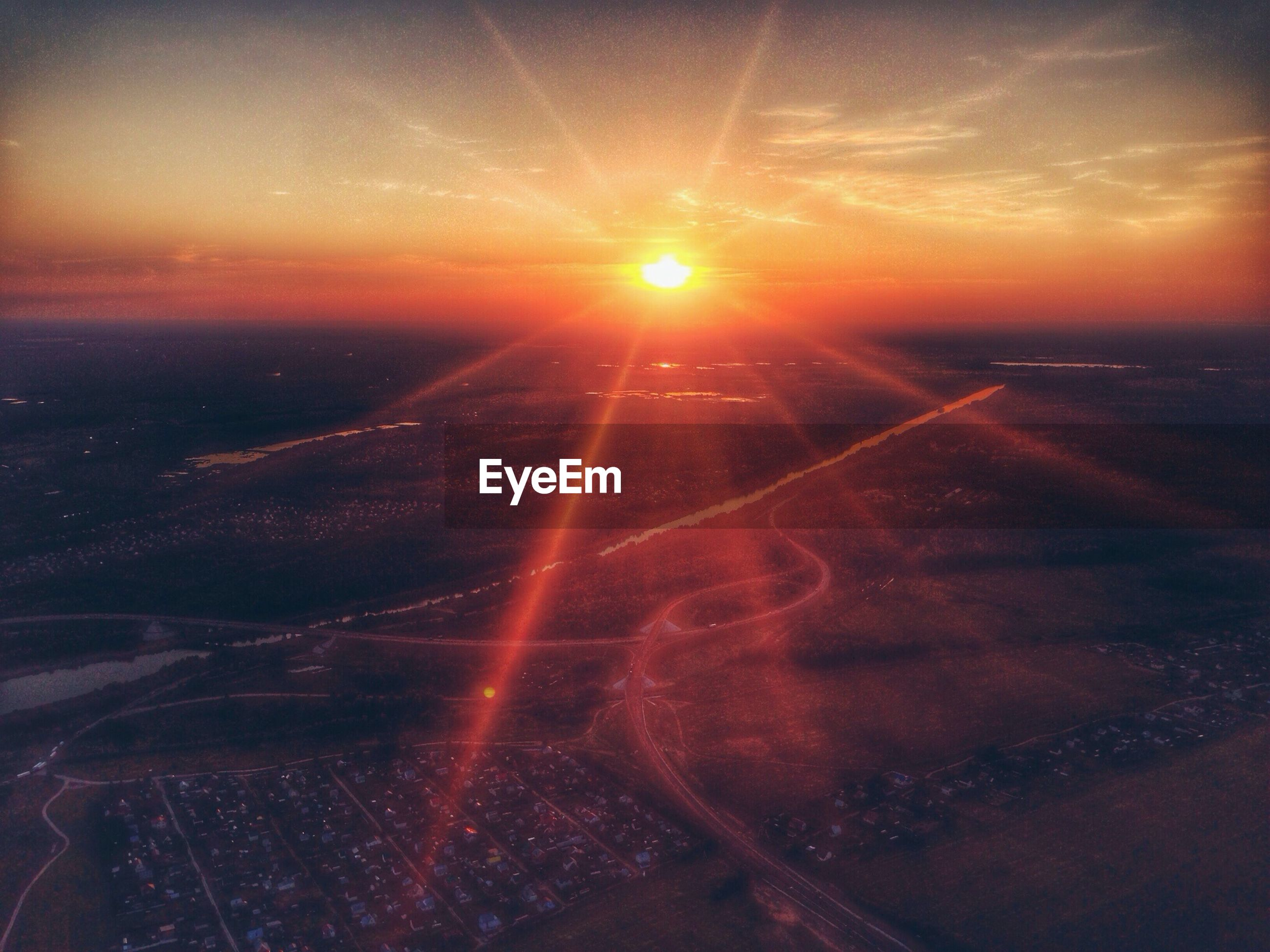 Aerial view of landscape at sunset